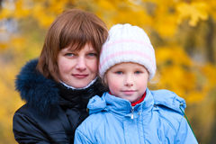 Mother with daughter in autumn city park Stock Photo