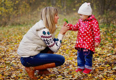 Mother with daughter in autumn forest Royalty Free Stock Photo