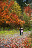 Mother and daughter in autumn forest Stock Image