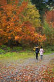 Mother and daughter in autumn forest Royalty Free Stock Photo