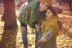 Mother with daughter in autumn Royalty Free Stock Image