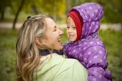 Mother and daughter in autumn park Stock Photos