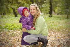 Mother and daughter in autumn park Stock Image