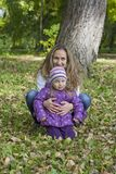 Mother and daughter in autumn park Stock Images