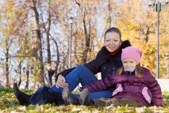 Mother with daughter  in autumn park Royalty Free Stock Photography