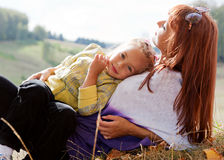 Mother and daughter are in autumn park. Mother and her daughter are in autumn park Royalty Free Stock Photos