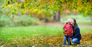 Mother and daughter at autumn park Royalty Free Stock Photos