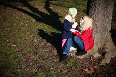 Mother and daughter in autumn park Royalty Free Stock Images