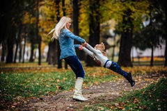 Mother with daughter in autumn park Stock Images