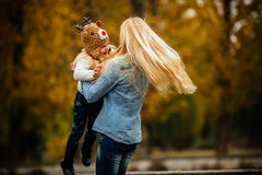 Mother with daughter in autumn park Stock Image