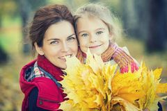 Mother and daughter in the autumn park stock photography