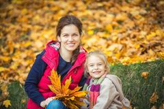 Mother and daughter in the autumn park Royalty Free Stock Photos