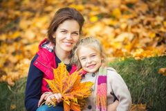 Mother and daughter in the autumn park Royalty Free Stock Photography
