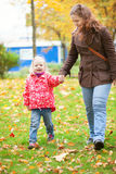 Mother and daughter in autumn park Royalty Free Stock Photos
