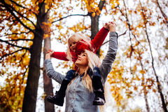 Mother with daughter in autumn park Royalty Free Stock Photo