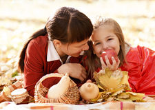 Mother with daughter on autumn picnic Stock Images