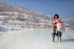 Mother and daughter on background limestone of Pamukkale, Turkey Royalty Free Stock Photo