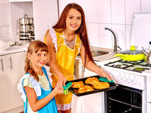 Mother and daughter bake cookies Stock Images