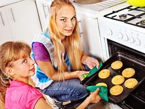 Mother and daughter bake cookies Stock Image
