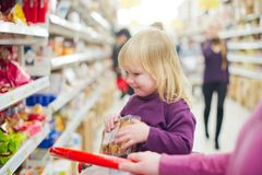 Mother and daughter in bakery in supermarket Stock Photos