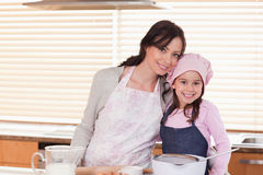 Mother and daughter baking. In a kitchen Stock Photos