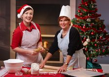 Mother and daughter baking christmas cake Royalty Free Stock Images