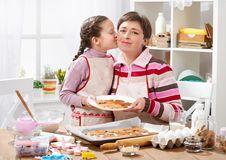 Mother and daughter baking cookies, home kitchen interior, healthy food concept Royalty Free Stock Photo