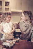 Mother and daughter baking. Mother and daughter baking cookies in kitchen Stock Photography