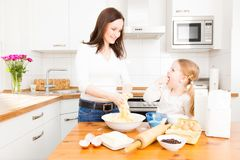 Mother And Daughter Baking Cookies. In their kitchen Stock Photography