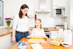 Mother And Daughter Baking Cookies. In their kitchen Royalty Free Stock Images