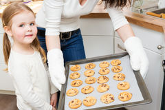 Mother And Daughter Baking Cookies. In their kitchen Stock Image