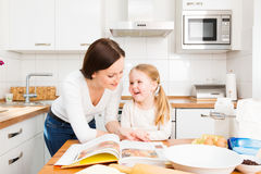 Mother And Daughter Baking Cookies. In their kitchen Royalty Free Stock Photo