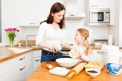 Mother And Daughter Baking Cookies. In their kitchen Royalty Free Stock Photos