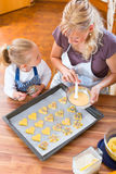 Mother and daughter baking cookies together Royalty Free Stock Image