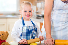 Mother and daughter baking cookies together Stock Images