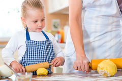Mother and daughter baking cookies together Royalty Free Stock Photo