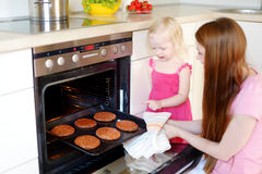 Mother and daughter baking cookies Stock Images