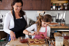 Mother and daughter baking at home Royalty Free Stock Images