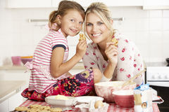 Mother And Daughter Baking In Kitchen Stock Photos