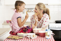 Mother And Daughter Baking In Kitchen Royalty Free Stock Photos