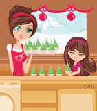 Mother and daughter Baking muffins in christmas Stock Image