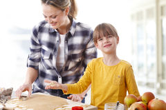 Mother and daughter baking Stock Image