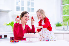 Mother and daughter baking strawberry pie Royalty Free Stock Photo