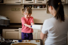 Mother and daughter baking together Royalty Free Stock Images