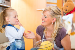 Mother and daughter baking together Royalty Free Stock Image