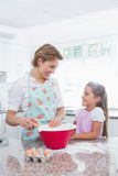 Mother and daughter baking together Stock Photography