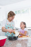 Mother and daughter baking together Stock Image