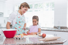 Mother and daughter baking together Stock Images