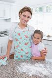 Mother and daughter baking together Stock Photo