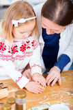 Mother and daughter baking together Stock Photos